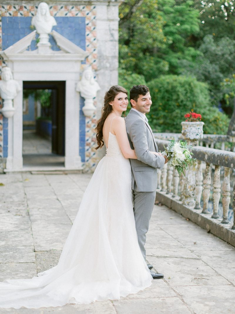 Merry newlyweds at Palácio Marquês de Fronteira in Lisbon by Portugal Wedding Photographer