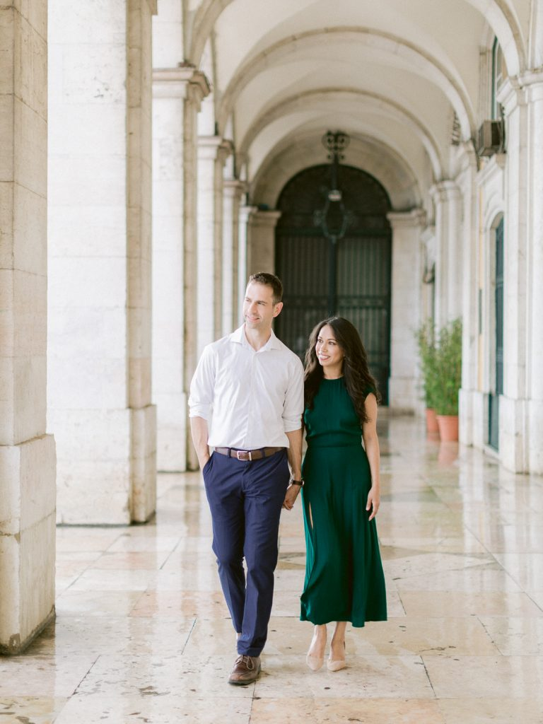 Elegant couple under arcade at Terreiro do Paço Lisbon by Portugal Wedding Photographer