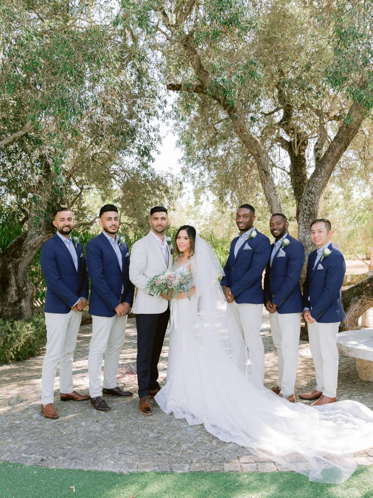 Bride, Groom and Groomsmen Wedding Portrait under cork oak tree by Portugal Wedding Photographer