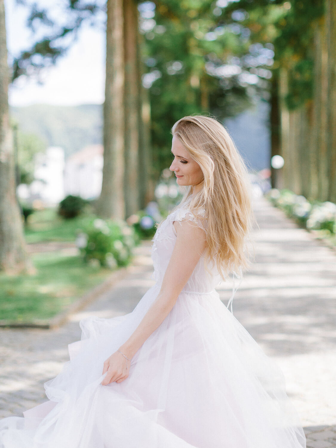 Bride twirling on her wedding day in the Azores by Portugal Wedding Photographer
