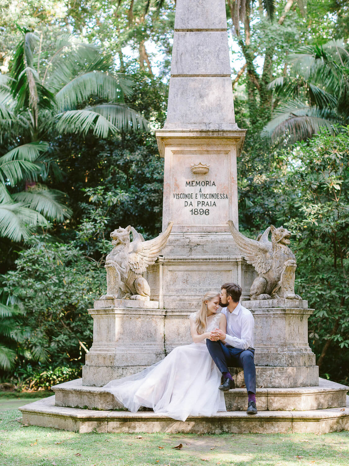 Wedding couple posing over monument in a park in Azores on their wedding day by Portugal Wedding Photographer
