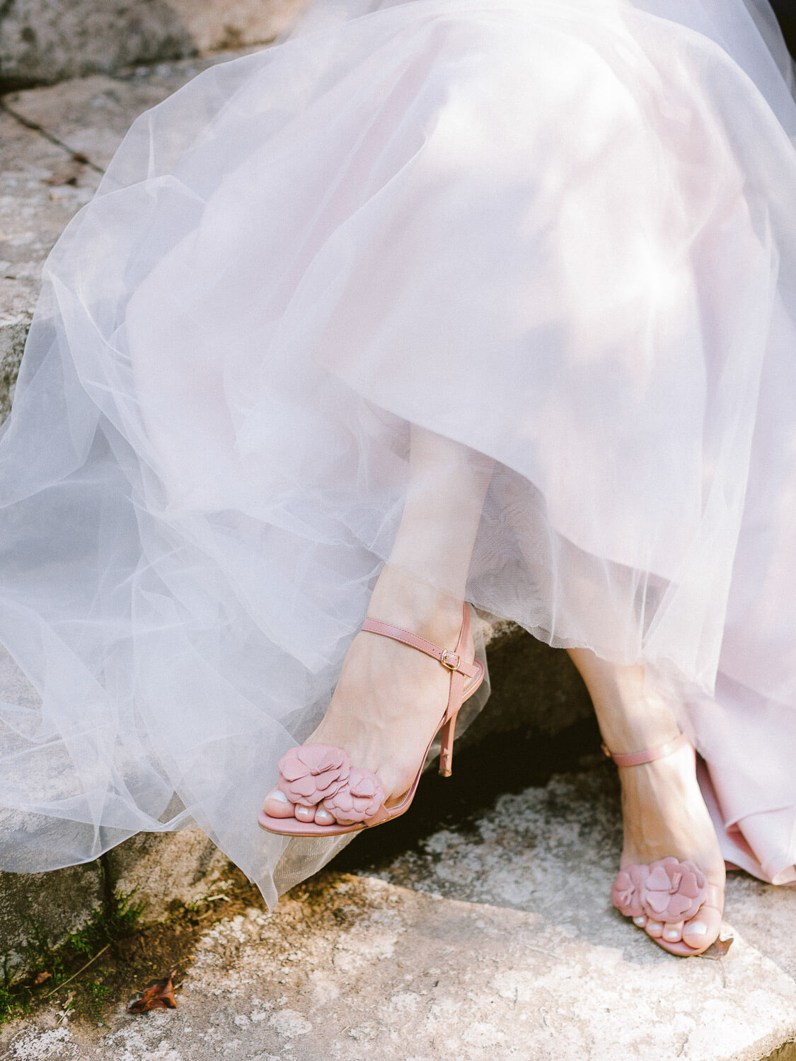 Detail of pink bridal shoes with floral details and bridal voluminous tule skirt by Portugal Wedding Photographer