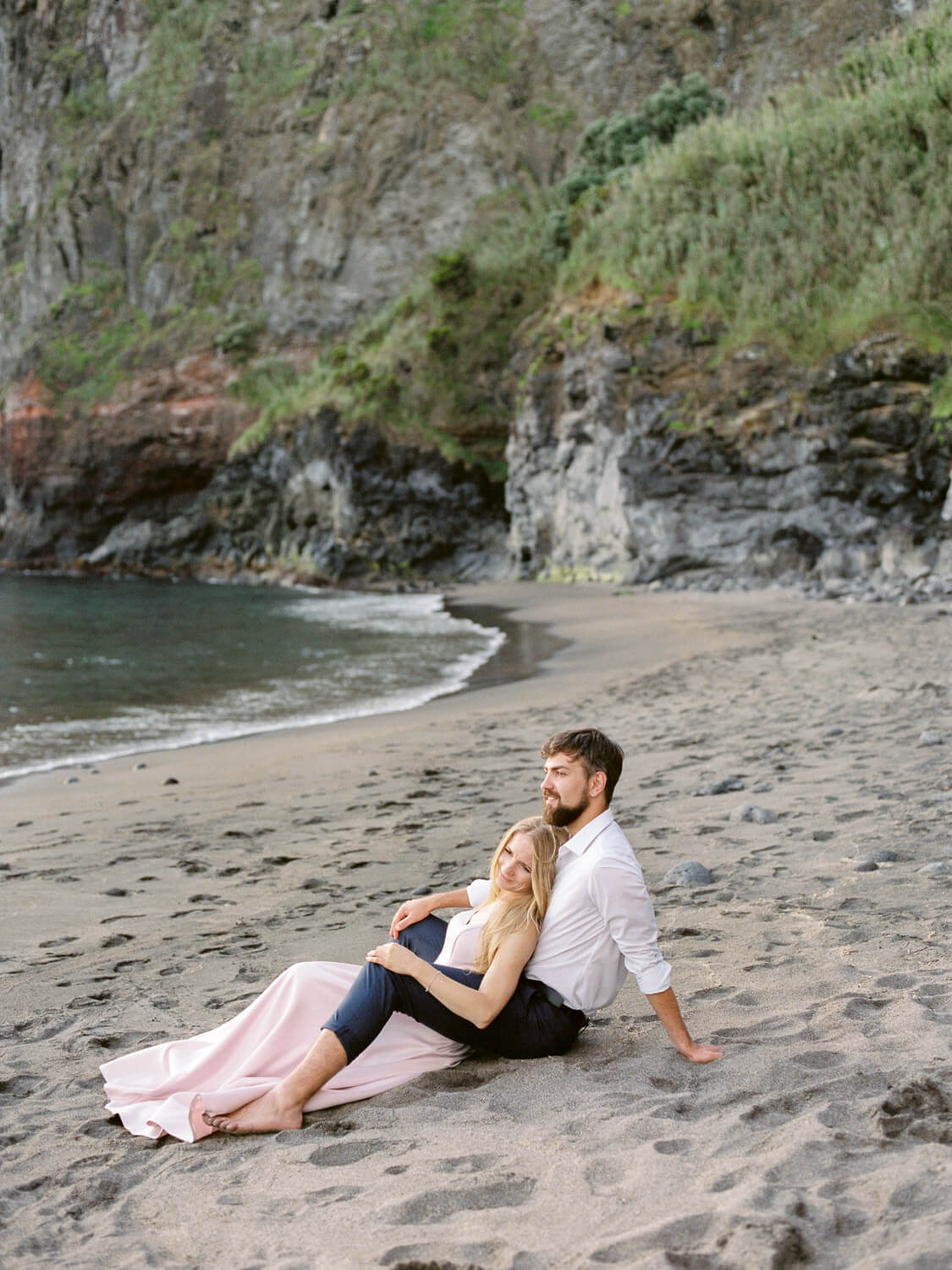 Wedding couple laying-back after their beach wedding in the Azores by Portugal Wedding Photographer