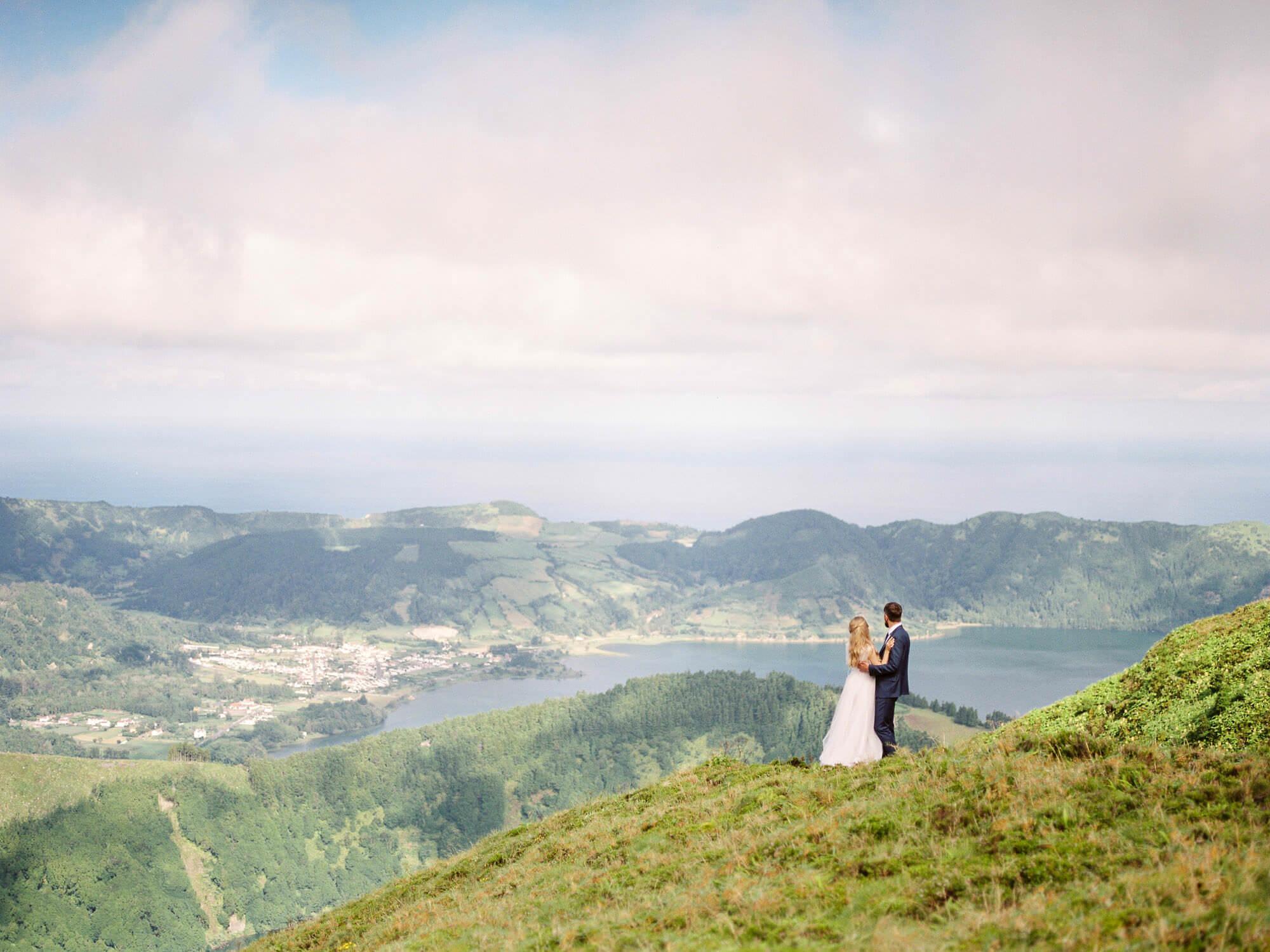 Wedding couple over Lagoa das Sete Cidades on their Destination Wedding in Azores by Portugal Wedding Photographer