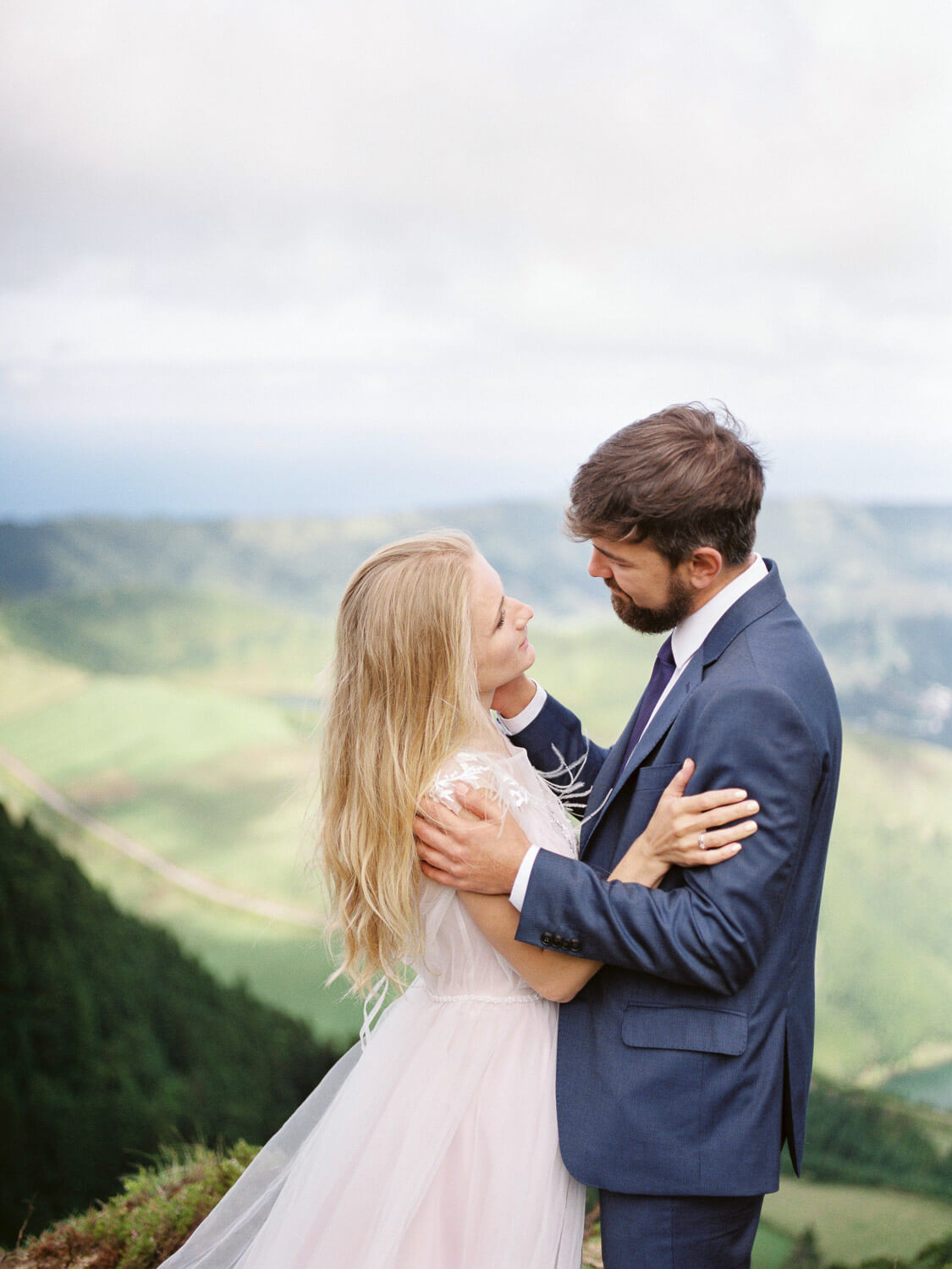 Sweet bride and groom look at each other on their wedding day in the Azores by Portugal Wedding Photographer