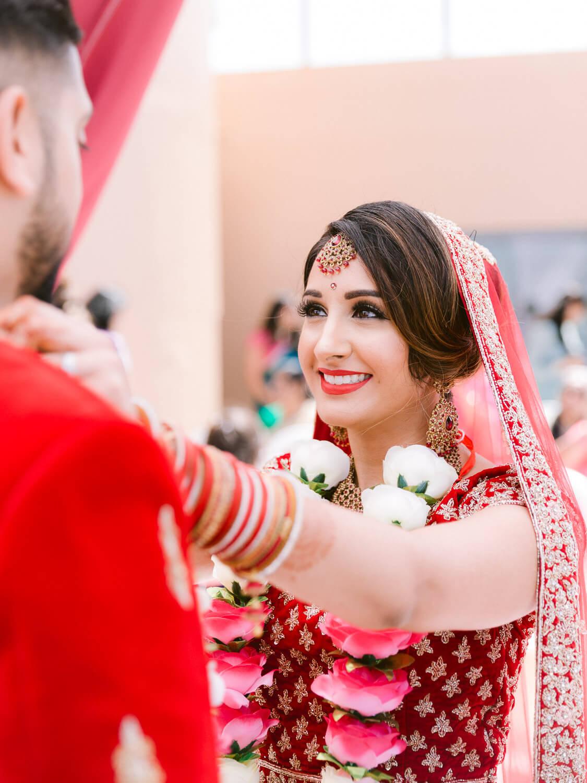 Joyous Hindu Bride on wedding ceremony by Portugal Wedding Photographer