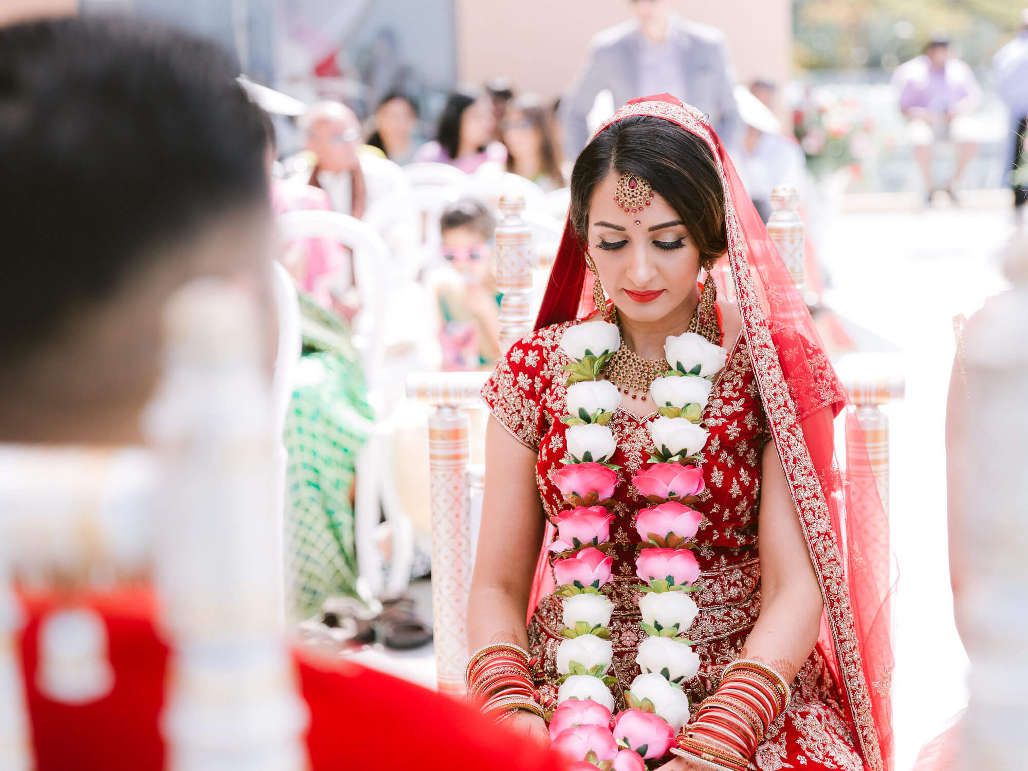 contemplating Indian bride during wedding ceremony by Portugal Wedding Photographer