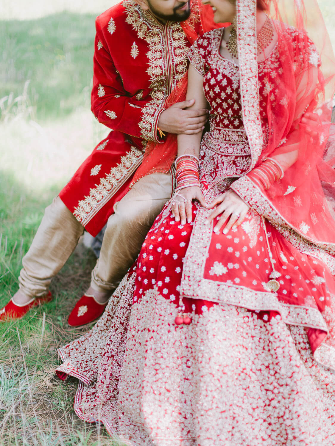 Hindu wedding couple details of gorgeous Hindu gowns by Portugal Wedding Photographer