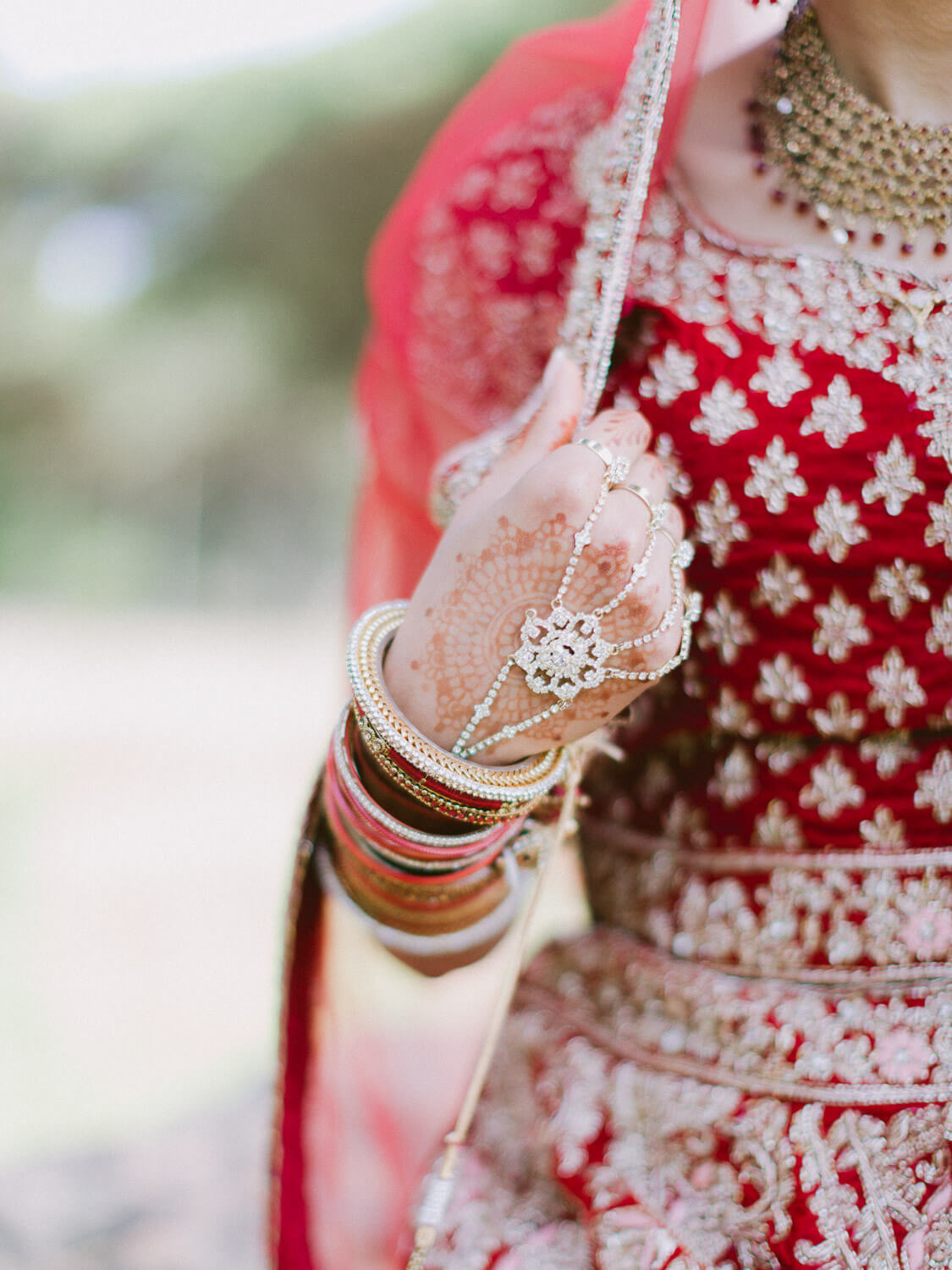 Hindu bride outfit details of gown and jewellery by Portugal Wedding Photographer