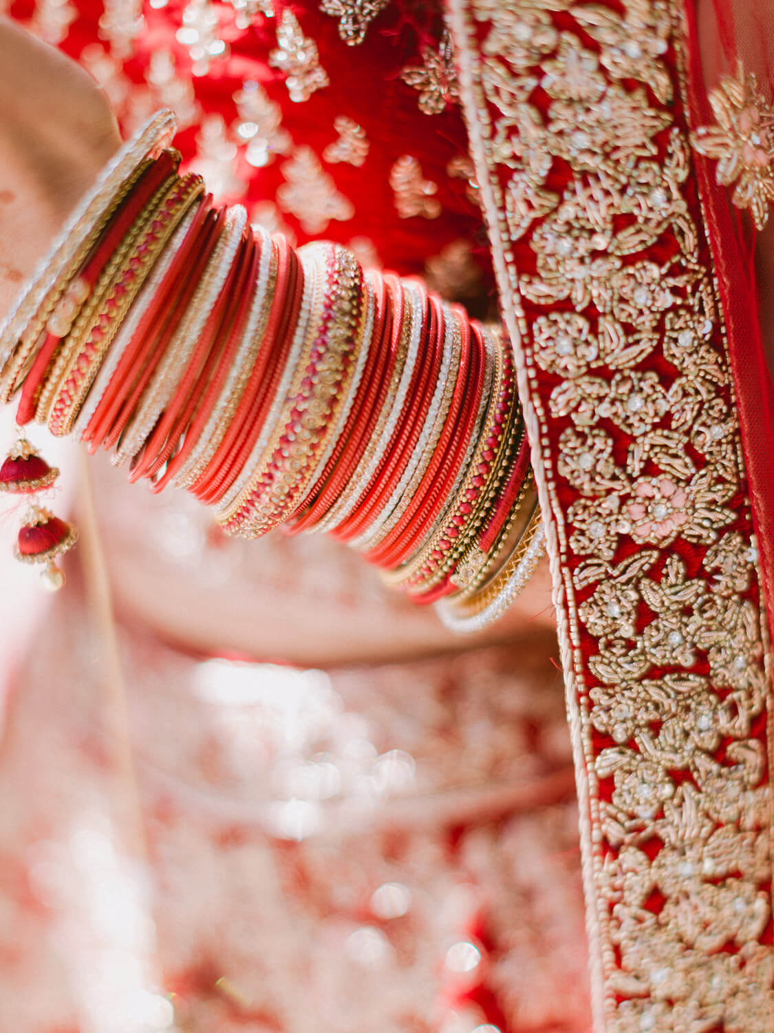 Hindu bride red and gold bracelets detail by Portugal Wedding Photographer