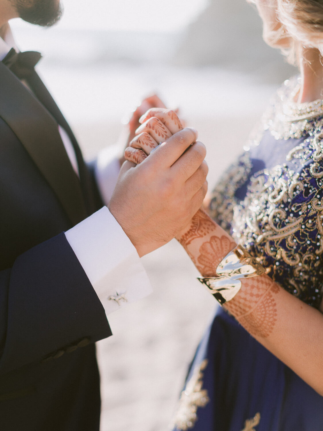 Hindu Bride and Groom holding hands detail by Portugal Wedding Photographer