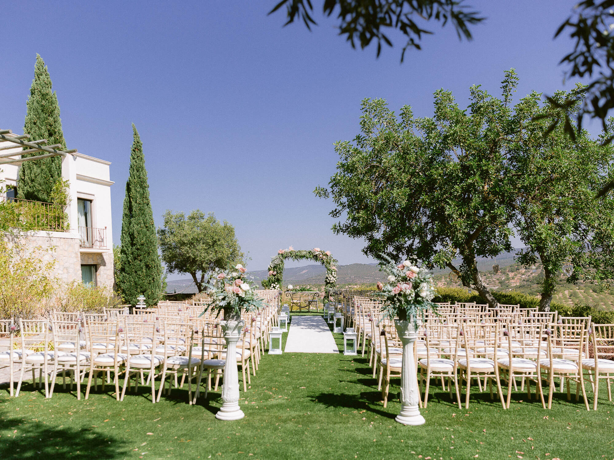 Wedding ceremony setting with floral arch for a destination wedding in the Algarve by Portugal Wedding Photographer