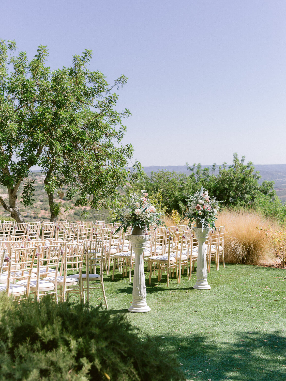 tall wedding ceremony flower arrangements for a destination wedding in the Algarve by Portugal Wedding Photographer