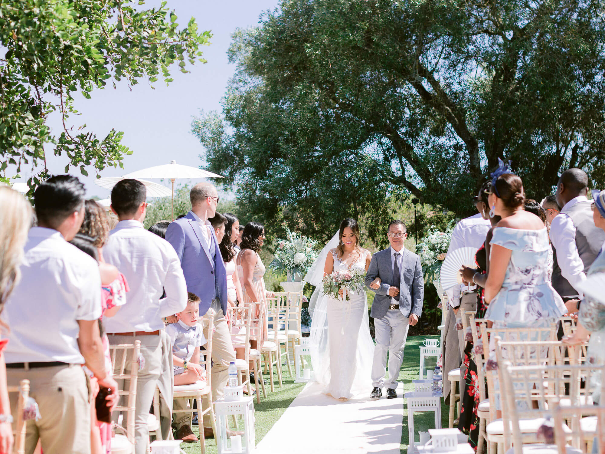 bridal walk on the aisle at an outdoor wedding in the Algarve by Portugal Wedding Photographer