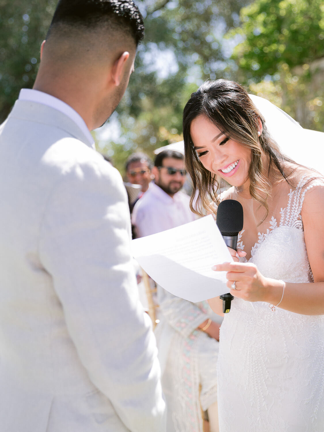 bride happily reading vows during a ceremony in the Algarve by Portugal Wedding Photographer