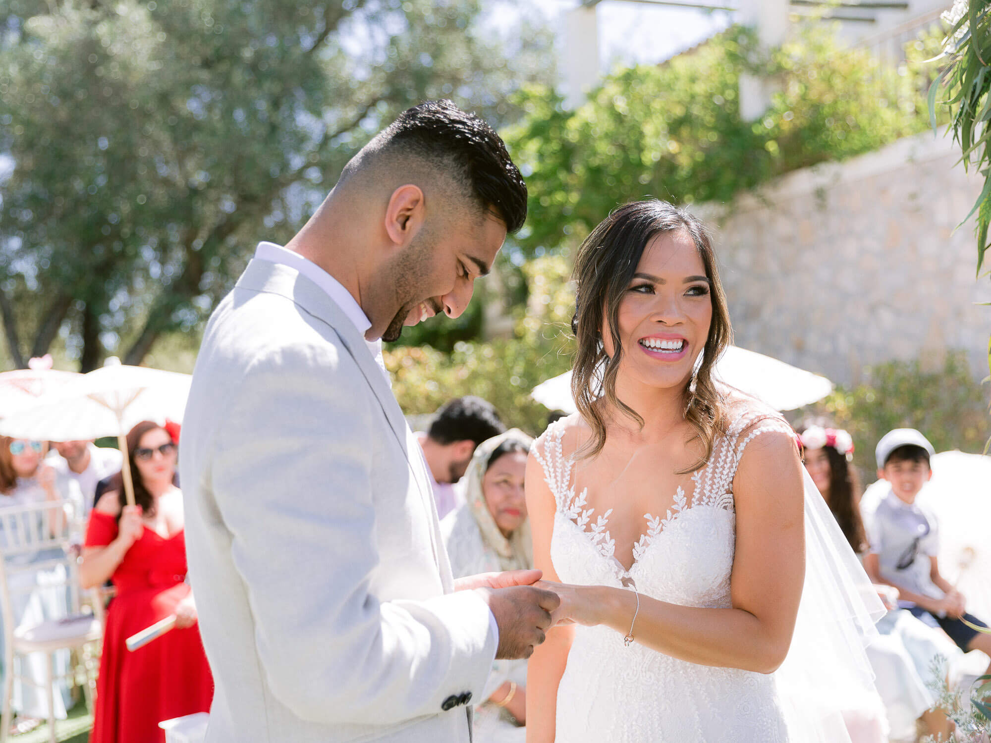 happy bride and groom during a ceremony in the Algarve by Portugal Wedding Photographer