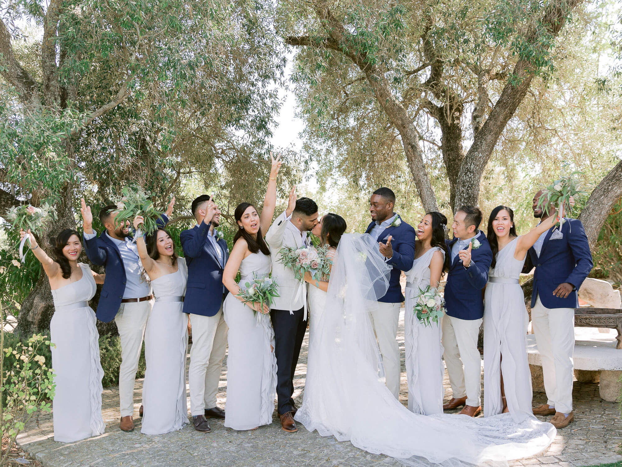 bride, groom, bridesmaids and groomsmen cheerful portrait at a wedding in the Algarve by Portugal Wedding Photographer