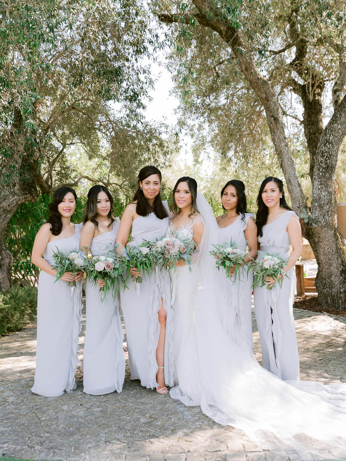 bride and bridesmaids portrait at a wedding in the Algarve by Portugal Wedding Photographer