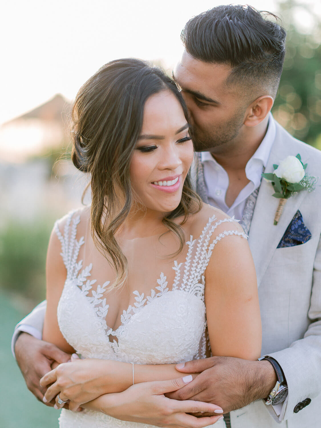 bride and groom's sweet embrace at a destination wedding in the Algarve by Portugal Wedding Photographer