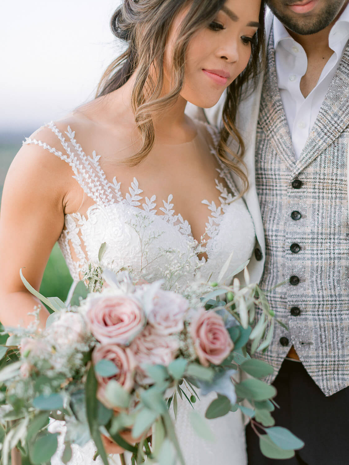 bride's close-up portrait with bouquet and gown details by Portugal Wedding Photographer
