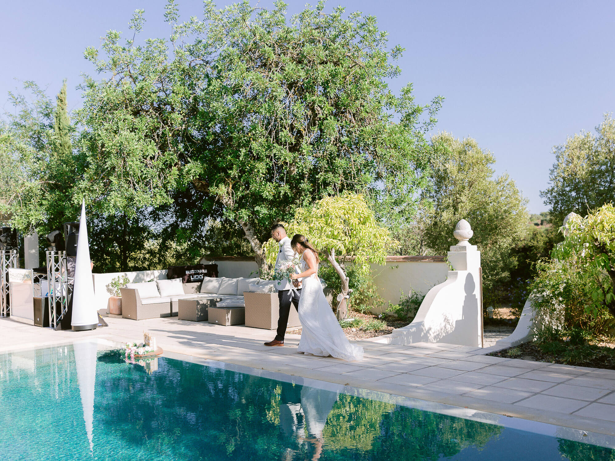 bride and groom walking by the pool at a destination wedding in the Algarve by Portugal Wedding Photographer