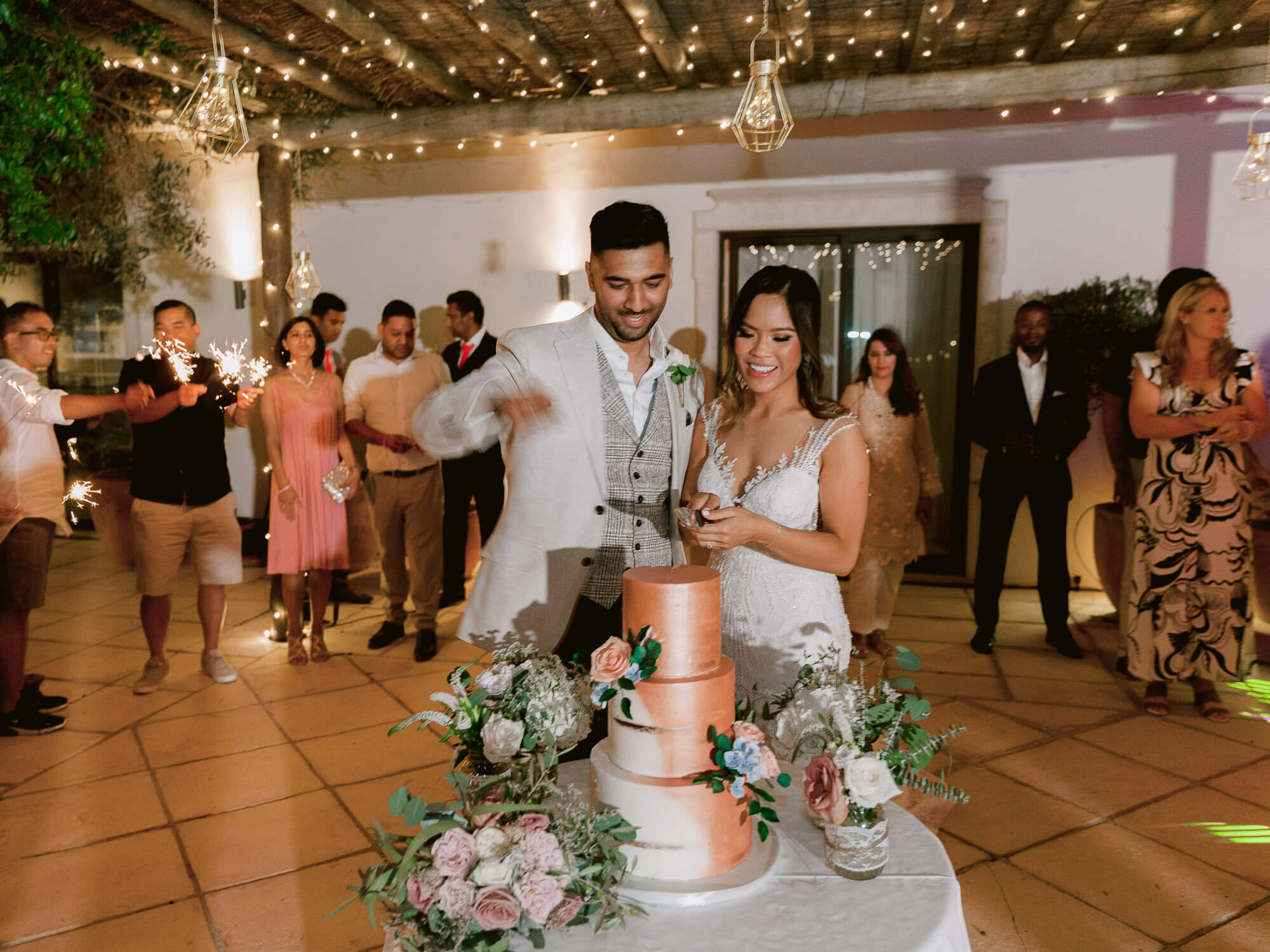 cake cutting ceremony at a destination wedding in the Algarve by Portugal Wedding Photographer
