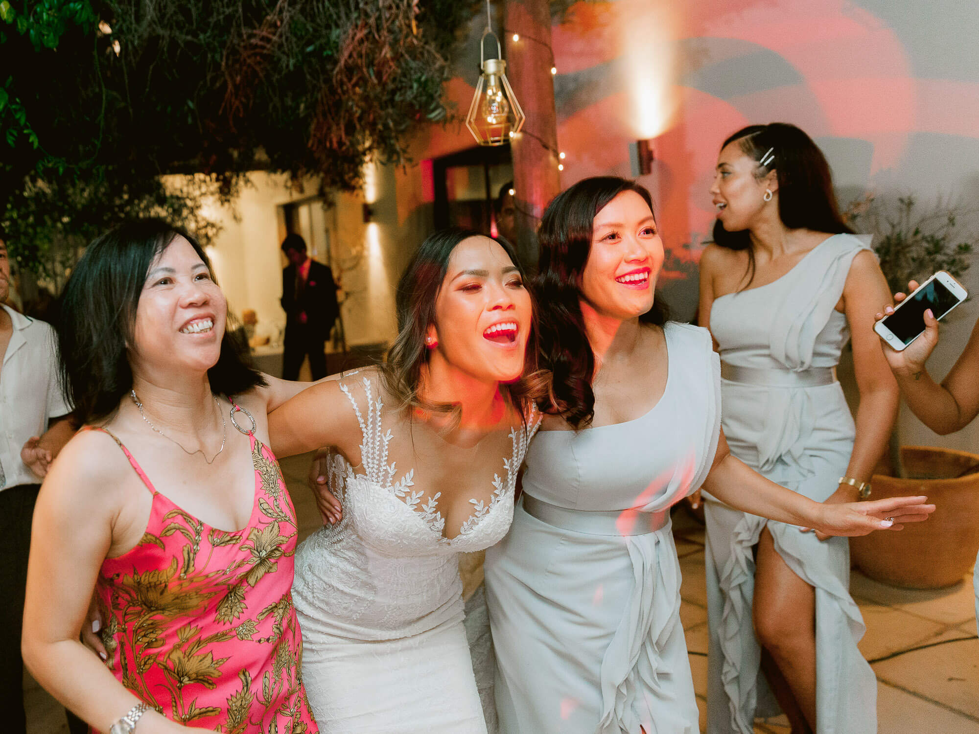 bride cheering with friends during the party at a destination wedding in the Algarve by Portugal Wedding Photographer