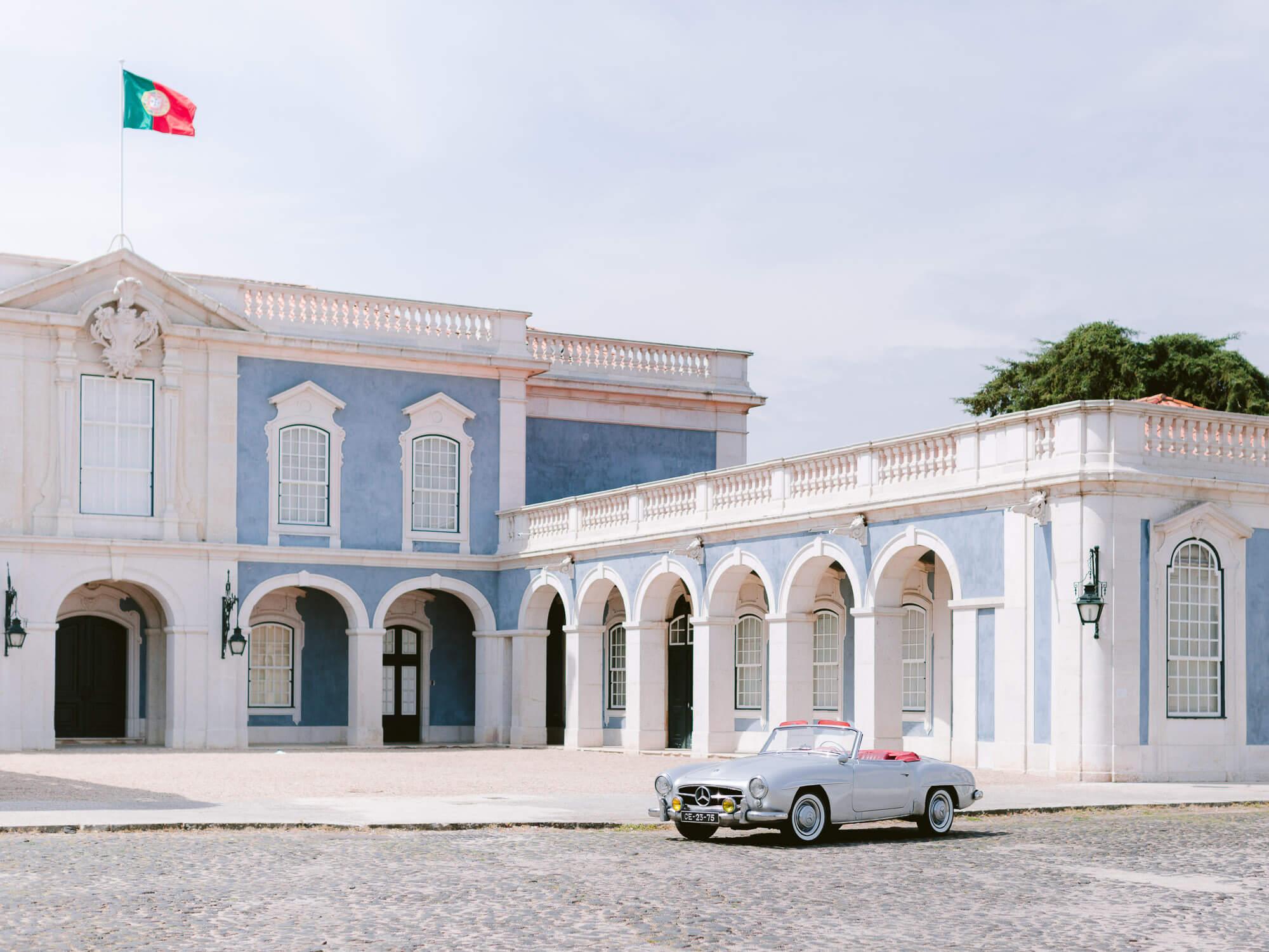 Palacio de Queluz beautiful facade and vintage Mercedes convertible car by Portugal Wedding Photographer