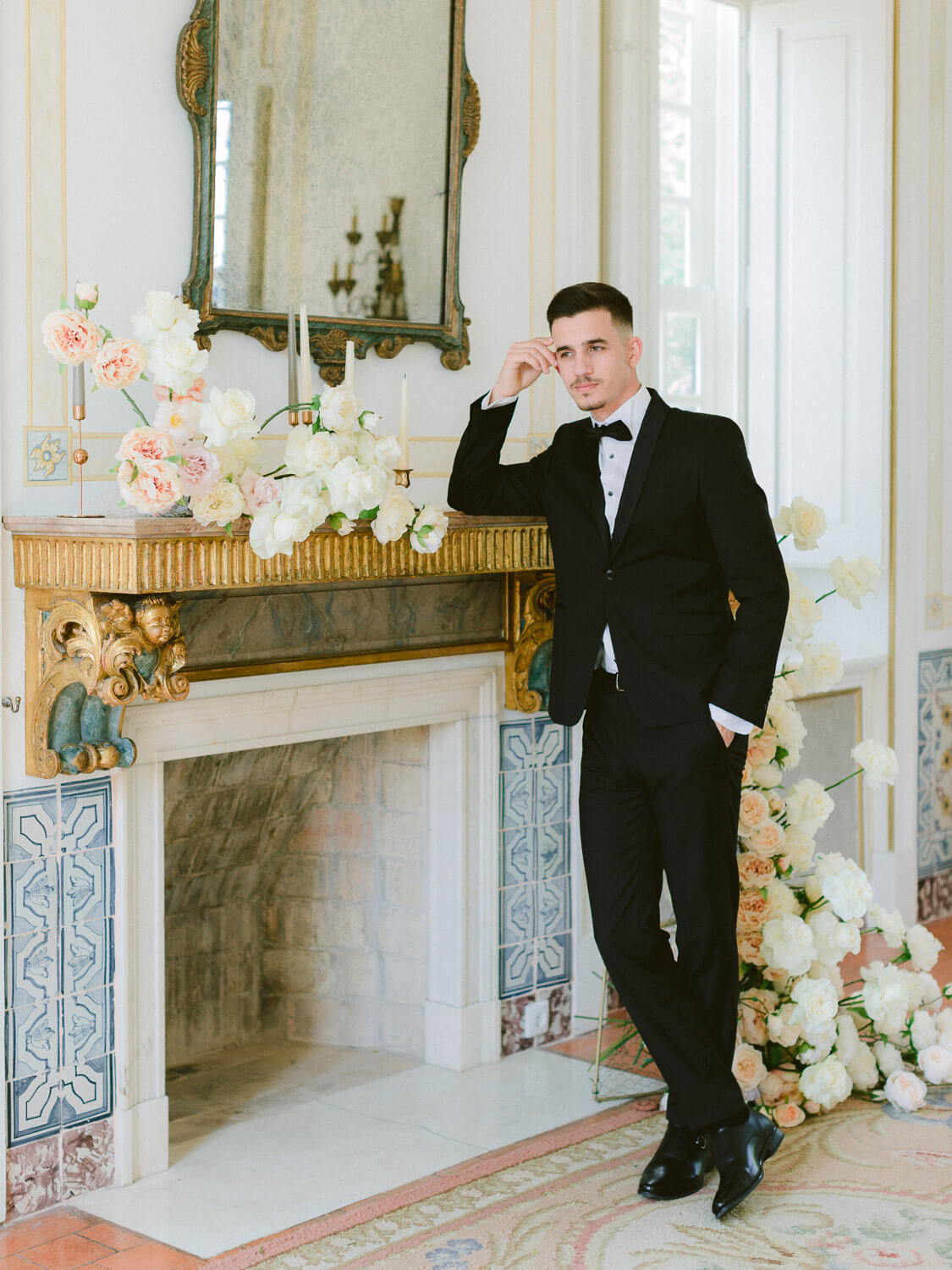 groom portrait over mantlepiece by Portugal Wedding Photographer
