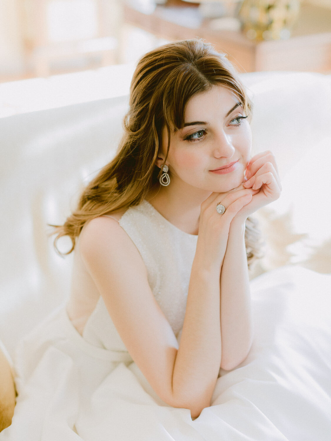 beautiful bride portrait showing glowing wedding ring and earring by Portugal Wedding Photographer