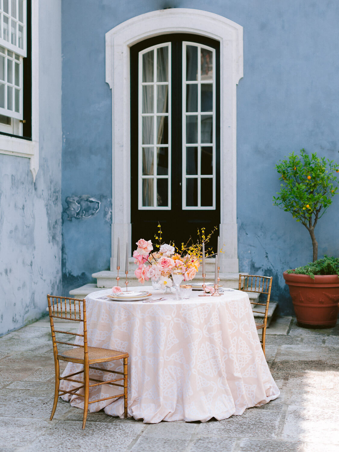 sweat-heart table with a floral centrepiece in outdoor reception wedding in Portugal by Portugal Wedding Photographer