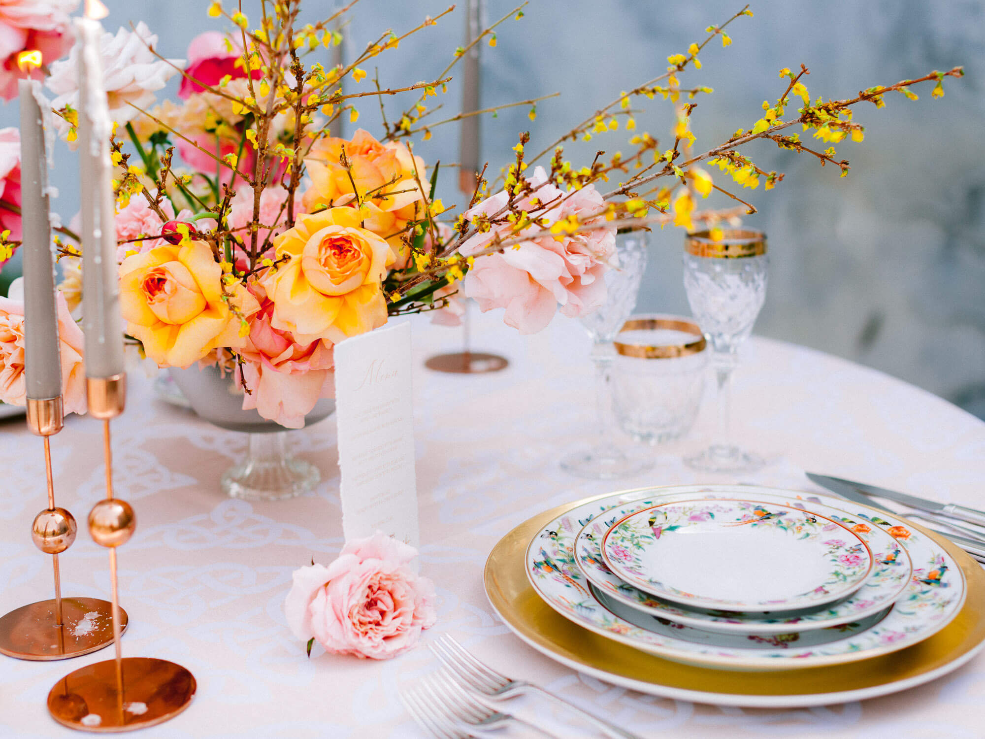 wedding reception table decoration with modern yellow floral centrepiece by Portugal Wedding Photographer