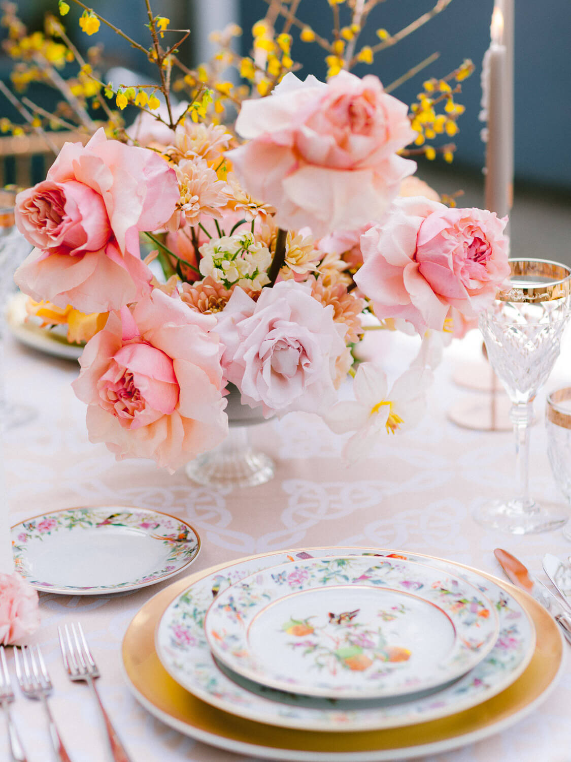 wedding reception table decoration with pink floral centrepiece by Portugal Wedding Photographer