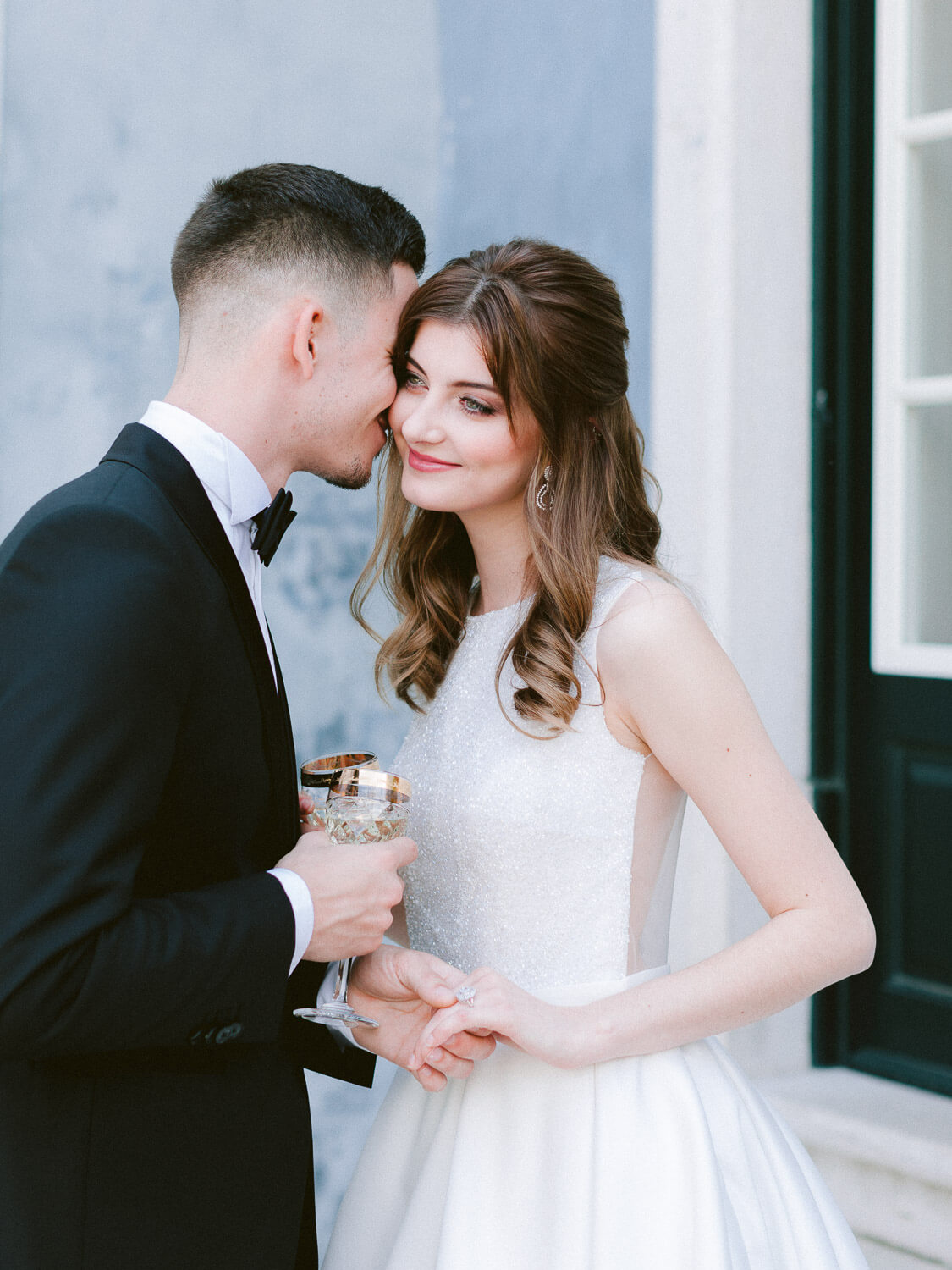 Groom whispering to his bride on the wedding day in Portugal by Portugal Wedding Photographer