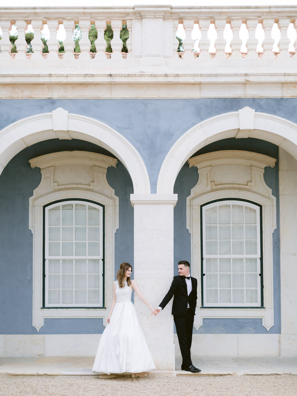 Gorgeous bride and groom portrait in front of beautiful Palacio de Queluz by Portugal Wedding Photographer