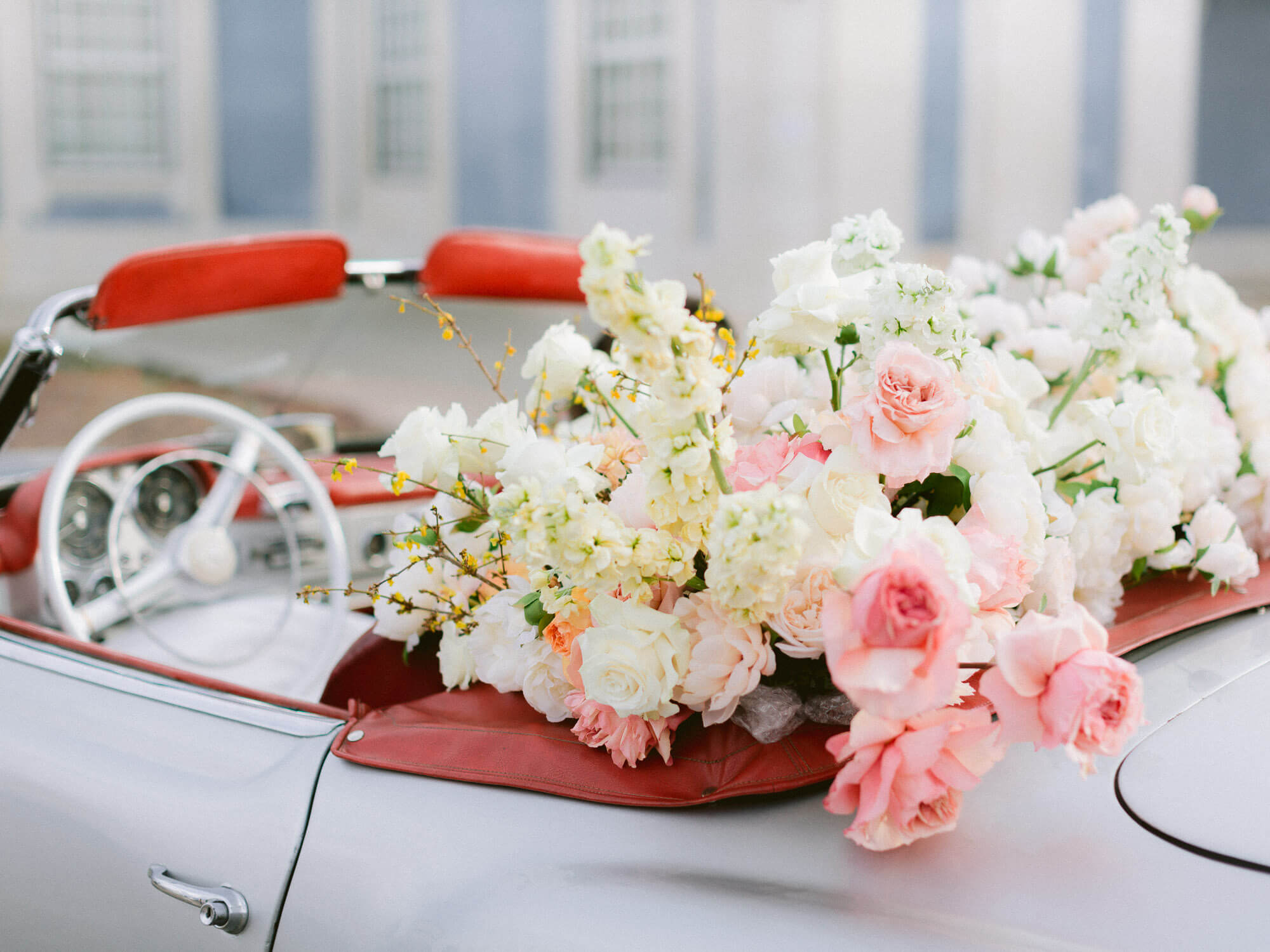 bridal floral decoration on convertible car by Portugal Wedding Photographer