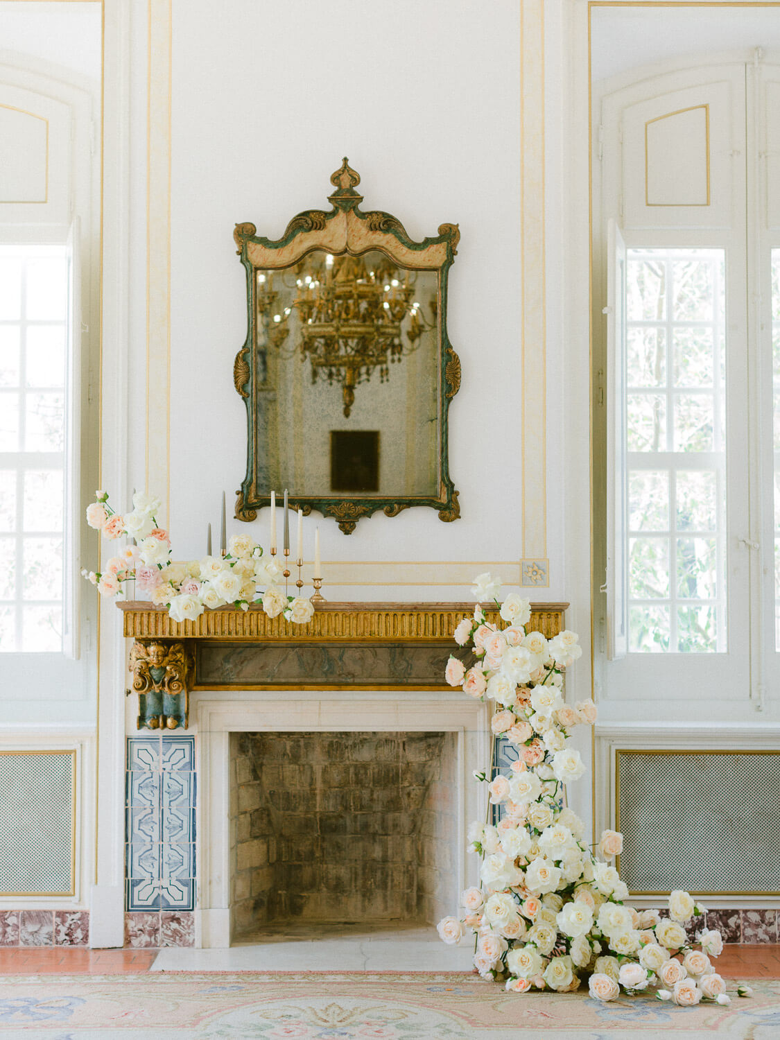 white and coral floral wedding decoration for mantlepiece at Palacio de Queluz photographed by Portugal Wedding Photographer