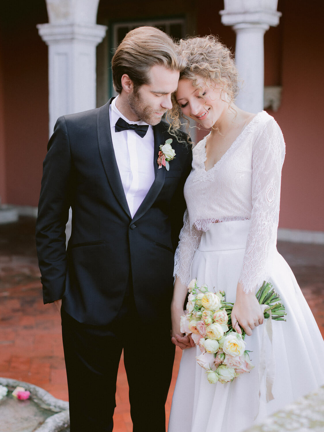 bride and groom's sweet cuddle in Casa dos Penedos Sintra by Portugal Wedding Photographer