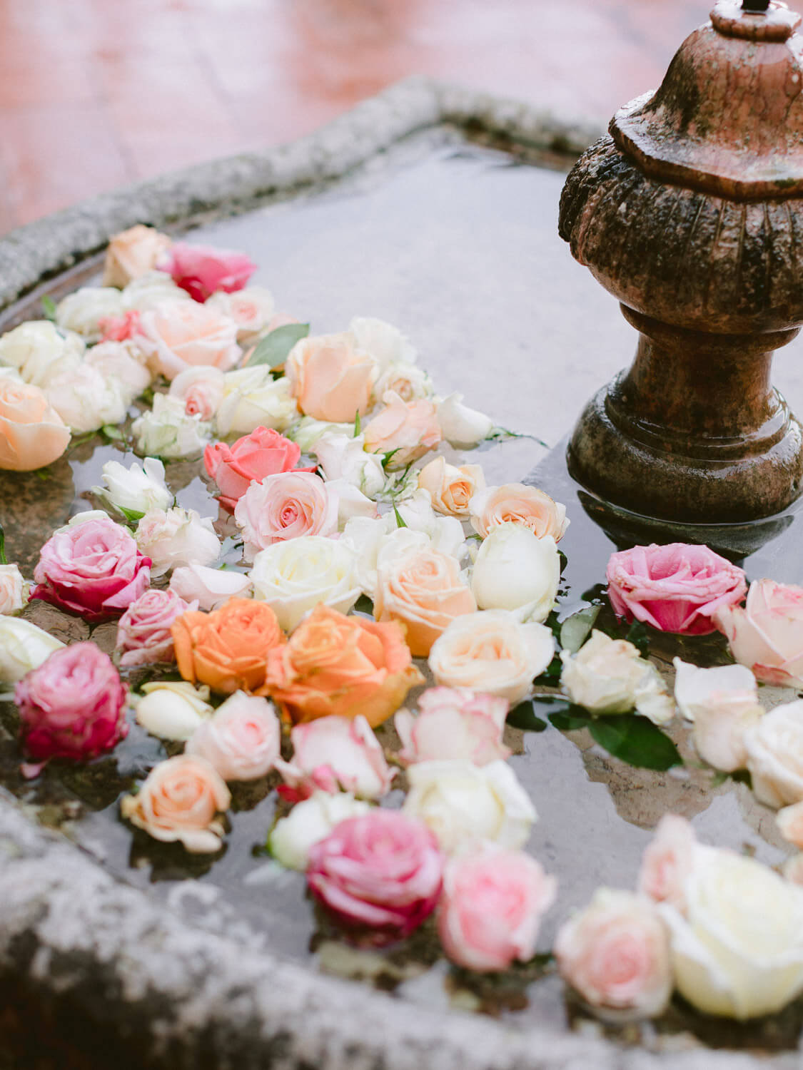 spring roses display on water fountain in Casa dos Penedos Sintra by Portugal Wedding Photographer