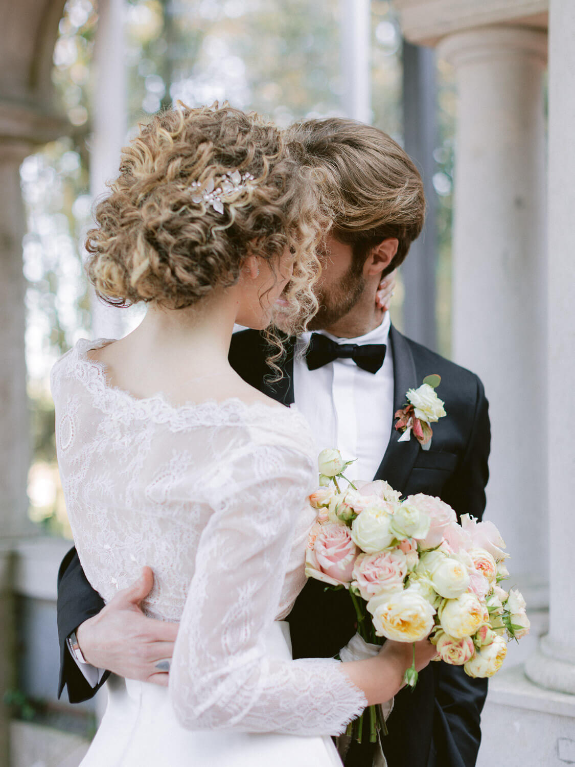 bride and groom's sweet embrace by Portugal Wedding Photographer