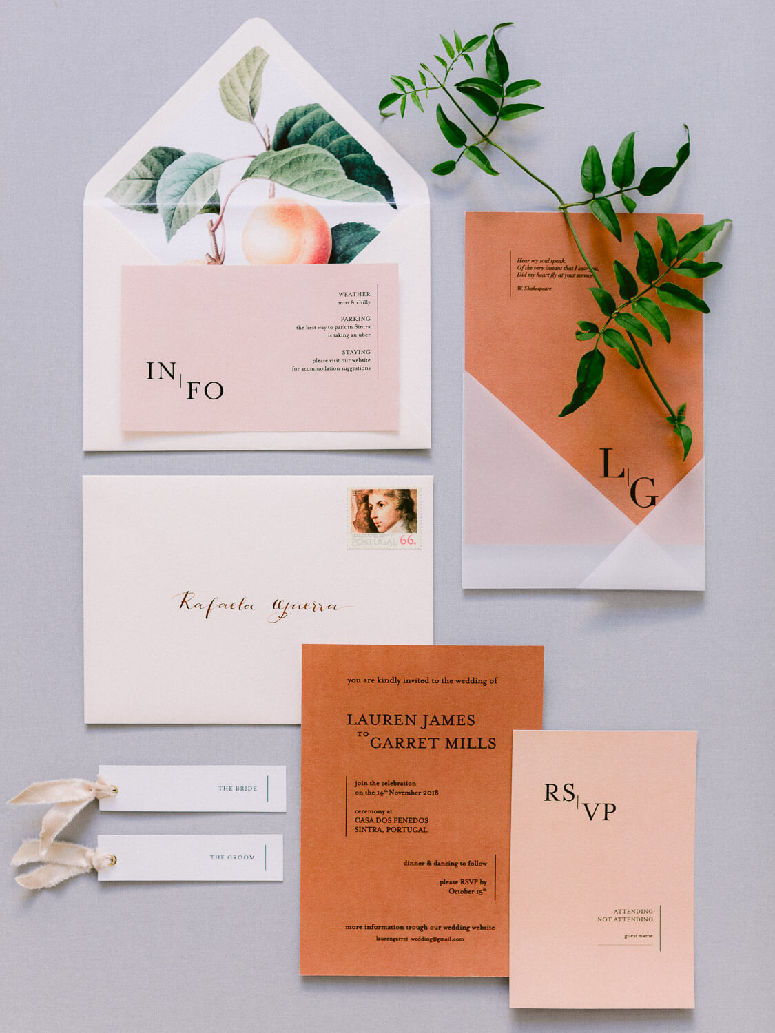 flat-lay with peach wedding stationery and greenery by Portugal Wedding Photographer