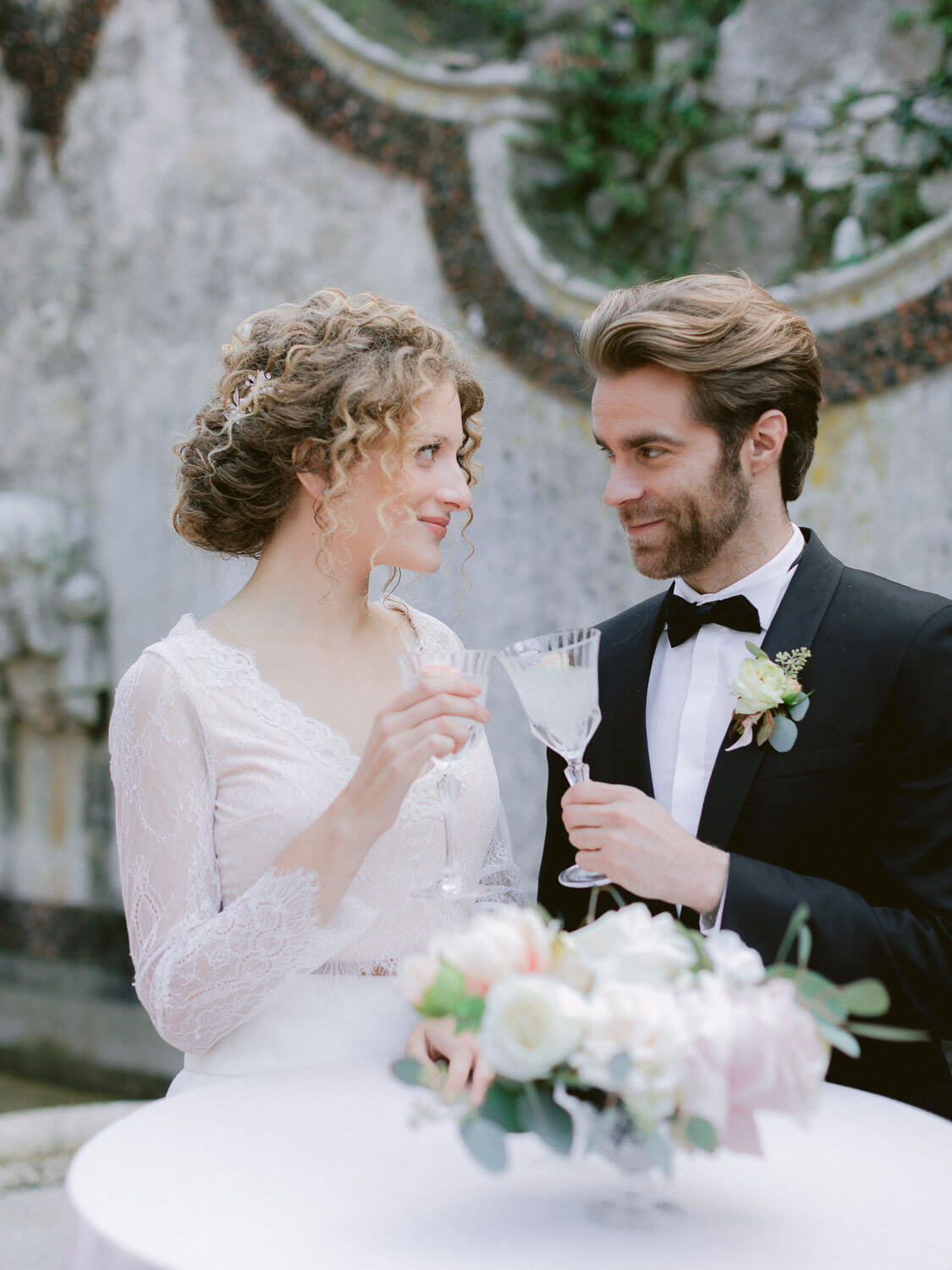 bride and groom's wedding toast by Portugal Wedding Photographer in Casa dos Penedos Sintra