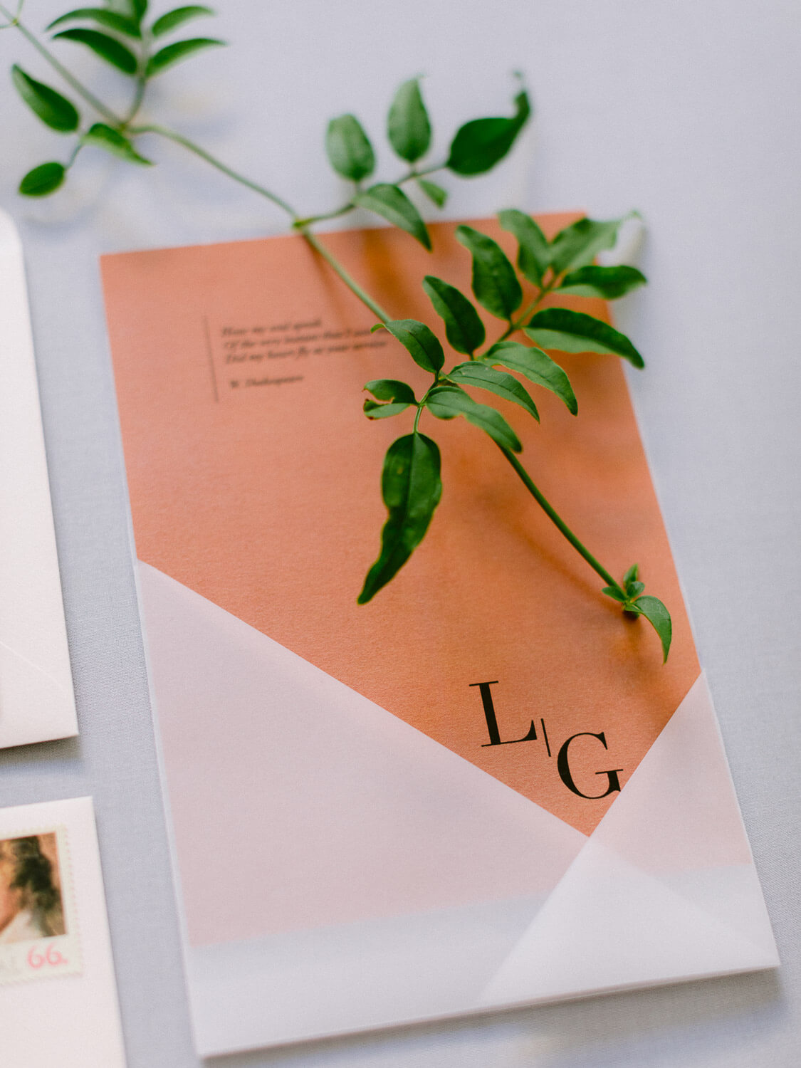peach wedding stationery and greenery detail by Portugal Wedding Photographer