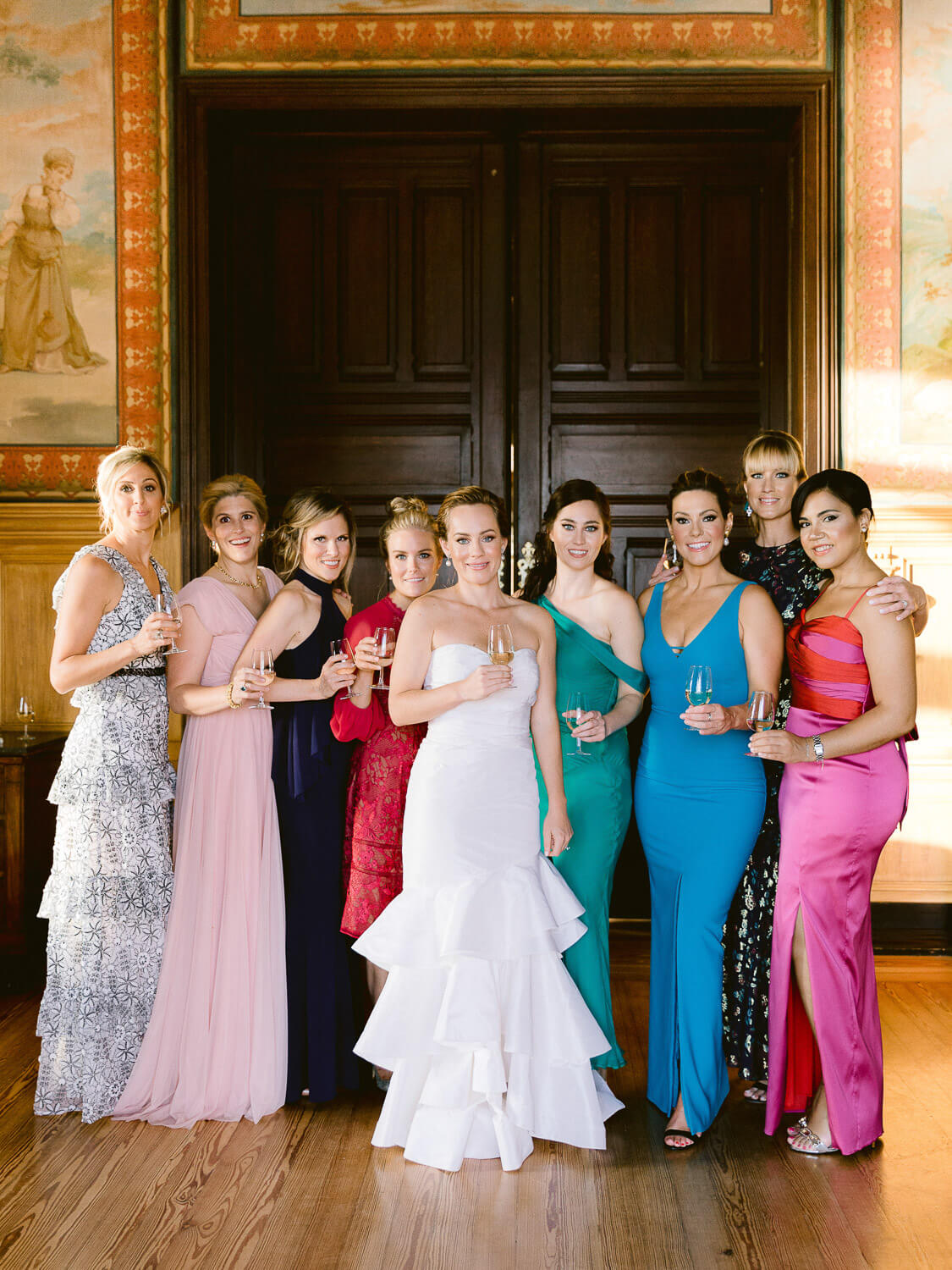 bridesmaids in colourful dresses and bride by Portugal Wedding Photographer