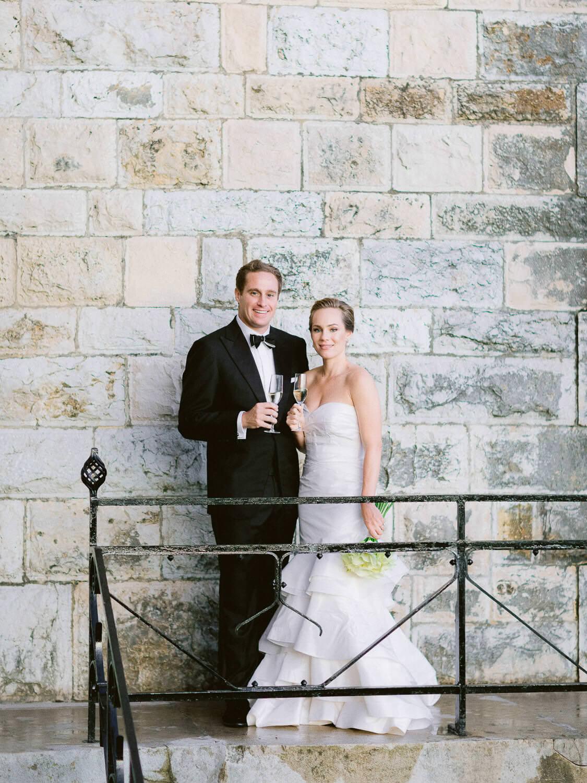 wedding couple's toast in Forte da Cruz's balcony by Portugal Wedding Photographer