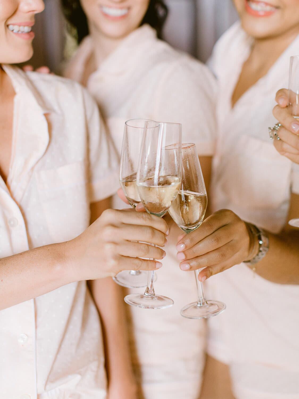 team bride toast by Portugal Wedding Photographer in Forte da Cruz