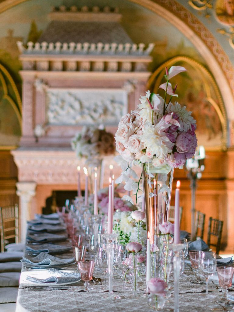Wedding reception table with tall pink floral centrepieces, Palácio de Monserrate by Portugal Wedding Photographer