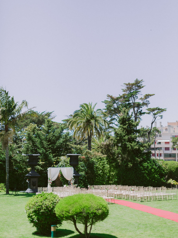 destination wedding ceremony set in the garden in Hotel Palacio Estoril by Portugal Wedding Photographer