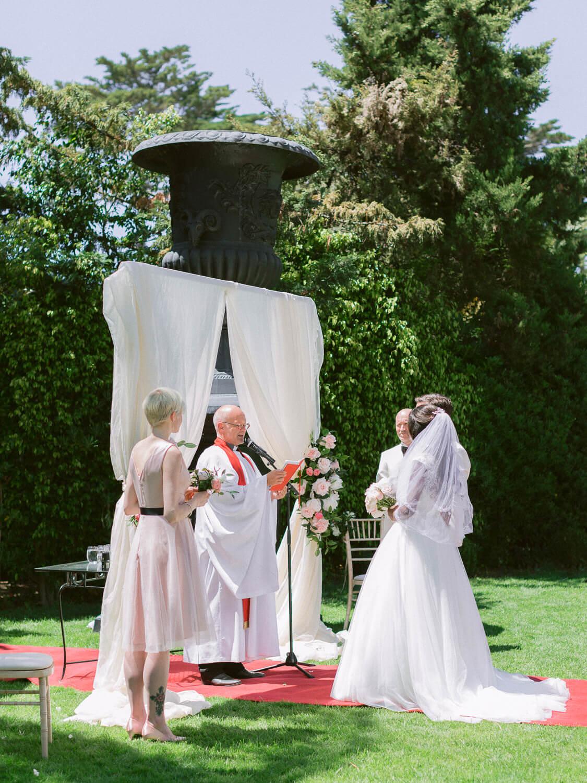 ceremony arch in the garden in Hotel Palacio Estoril by Portugal Wedding Photographer