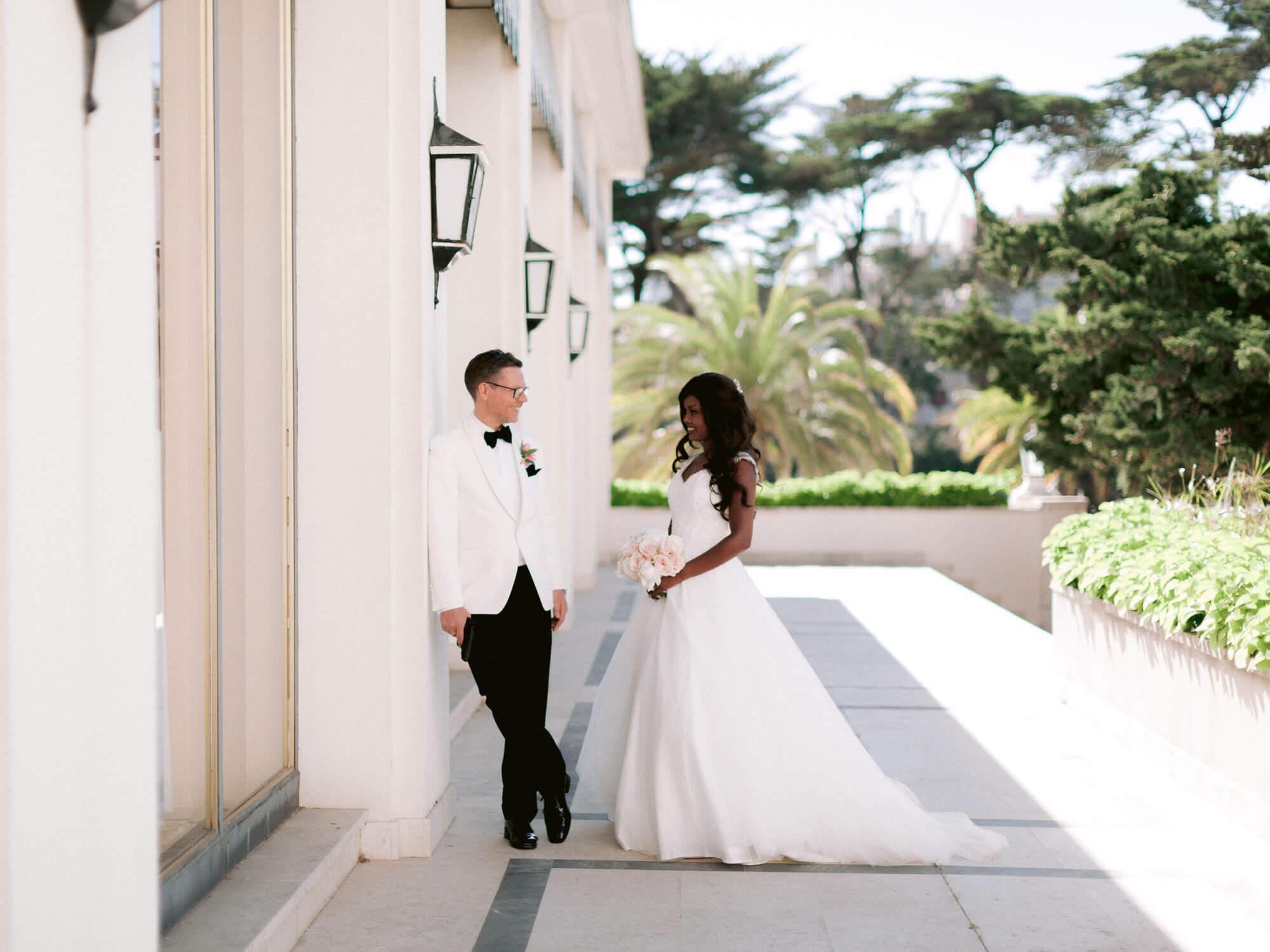 bride and groom romantic look in Hotel Palacio Estoril by Portugal Wedding Photographer